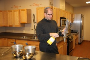 Rabbi Jason Miller koshering a kitchen